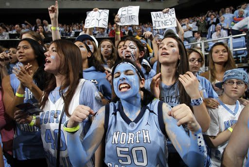 North Carolina fans cheer before an NCAA college basketball game against Duke in Chapel Hill, N.C., Wednesday, Feb. 8, 2012. (AP Photo/Jim R. Bounds)