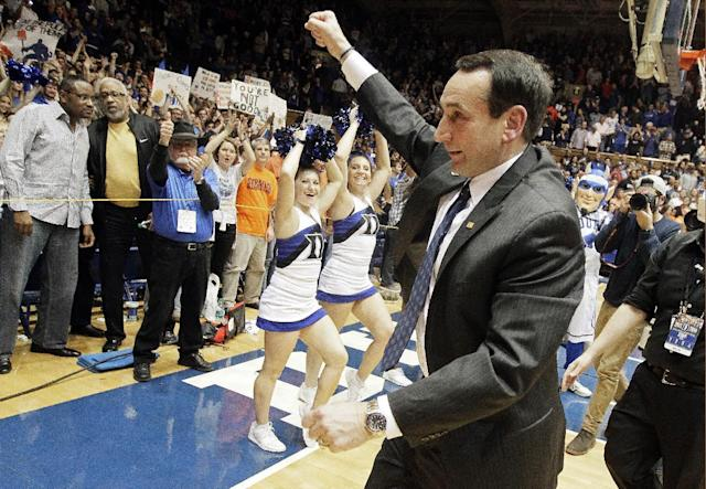 Duke coach Mike Krzyzewski celebrates following Duke's 66-60 win over Syracuse in an NCAA college basketball game in Durham, N.C., Saturday, Feb. 22, 2014. (AP Photo/Gerry Broome)