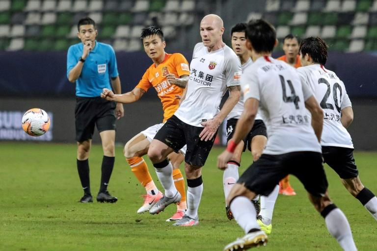 Aaron Mooy (centre) said he hadn't been expecting to make his debut for Shanghai SIPG on his 30th birthday, but then scored with a cool finish to celebrate