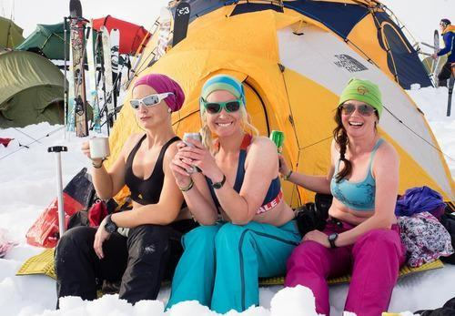 skiers mugging outside their tent