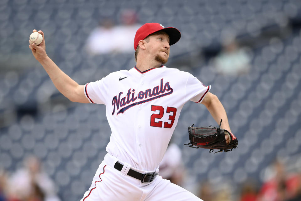 Washington Nationals starting pitcher Erick Fedde delivers a pitch during the first baseball game of a doubleheader against the San Francisco Giants, Saturday, June 12, 2021, in Washington. (AP Photo/Nick Wass)