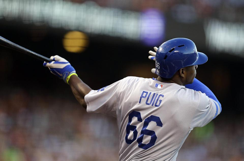 Los Angeles Dodgers' Yasiel Puig follows through on a double off San Francisco Giants' Tim Lincecum in the second inning of a baseball game Friday, July 25, 2014, in San Francisco. (AP Photo)