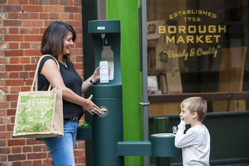 New fountains: Henry Harrison, 5, and Ellie Weehuizen have a drink at Borough Market: Lucy Young