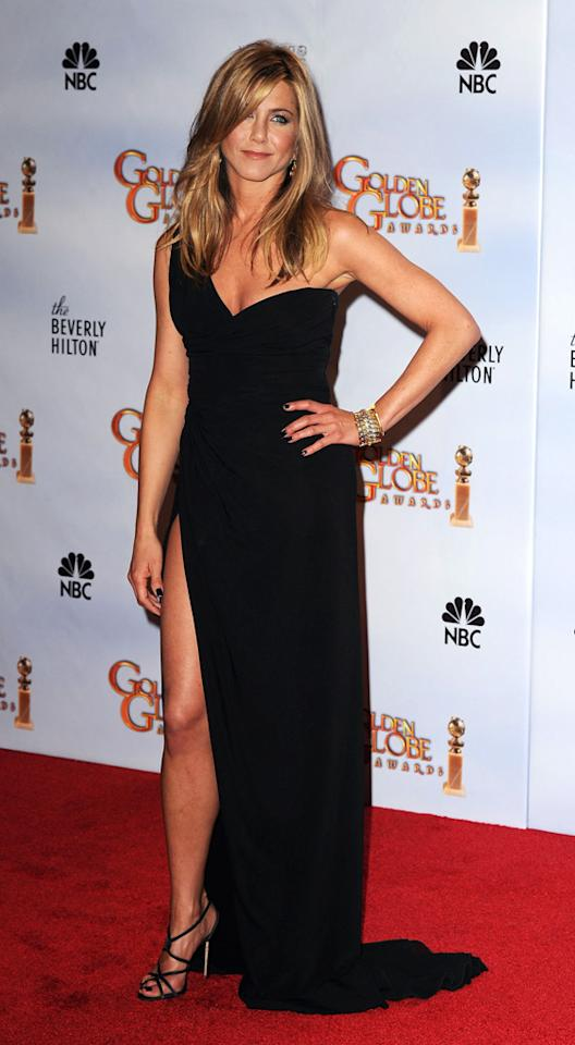 2010 Golden Globes    Aniston stunned in a one-shouldered Valentino that was anything but classic black. The thigh high slit was the perfect showcase for the actress to flaunt her hot gams, and her Versace heels and Fred Leighton jewelry complete the look.