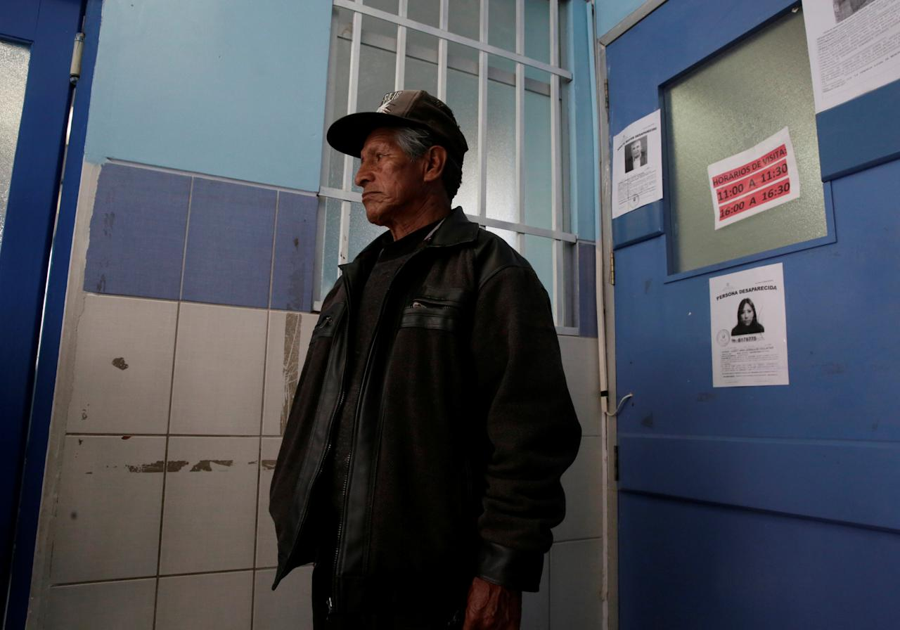 A man waits for news about his relative at the emergency room of the General Hospital during a strike by healthcare employees against Bolivia's government policies for health rules, in La Paz, Bolivia, December 12, 2017. REUTERS/David Mercado