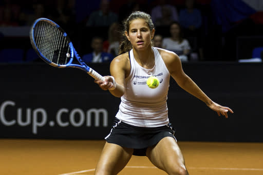 Germany's Julia Goerges returns a ball to Petra Kvitova during a single match of the tennis Fed Cup semifinal between Germany and Czech Republic in Stuttgart, Germany, Saturday, April 21, 2018. (Thomas Niedermueller/dpa via AP)
