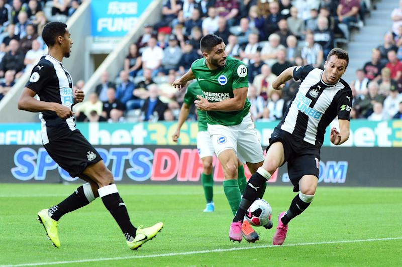 NEWCASTLE UPON TYNE, ENGLAND - SEPTEMBER 21: Neal Maupay of Brighton and Hove Albion shoots at goal challenged by Javier Manquillo of Newcastle United during the Premier League match between Newcastle United and Brighton & Hove Albion at St. James Park on September 21, 2019 in Newcastle upon Tyne, United Kingdom. (Photo by Mark Runnacles/Getty Images)