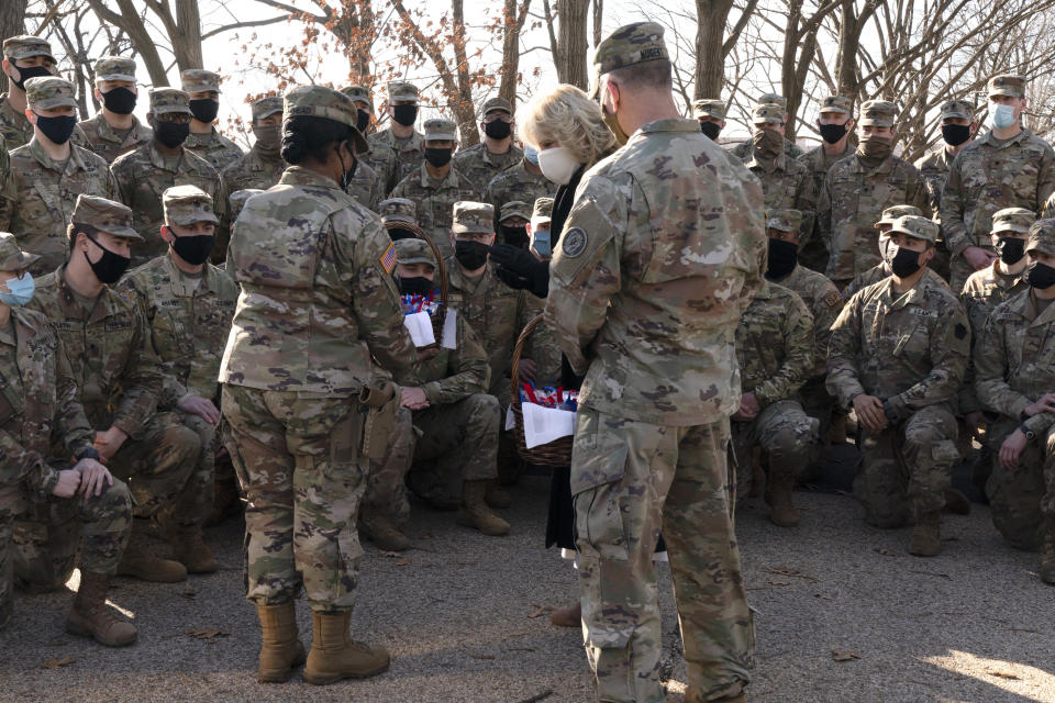 """Saying, """"the Biden's are a National Guard family,"""" first lady Jill Biden talks with soldiers after a group photo while surprising members of the National Guard with chocolate chip cookies, Friday, Jan. 22, 2021, at the U.S. Capitol in Washington. (AP Photo/Jacquelyn Martin, Pool)"""