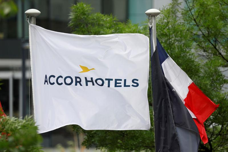 FILE PHOTO: The logo of French hotel operator AccorHotels is seen on a flagpole at the financial and business district of La Defense in Puteaux, near Paris, France, May 16, 2018. REUTERS/Charles Platiau/File Photo