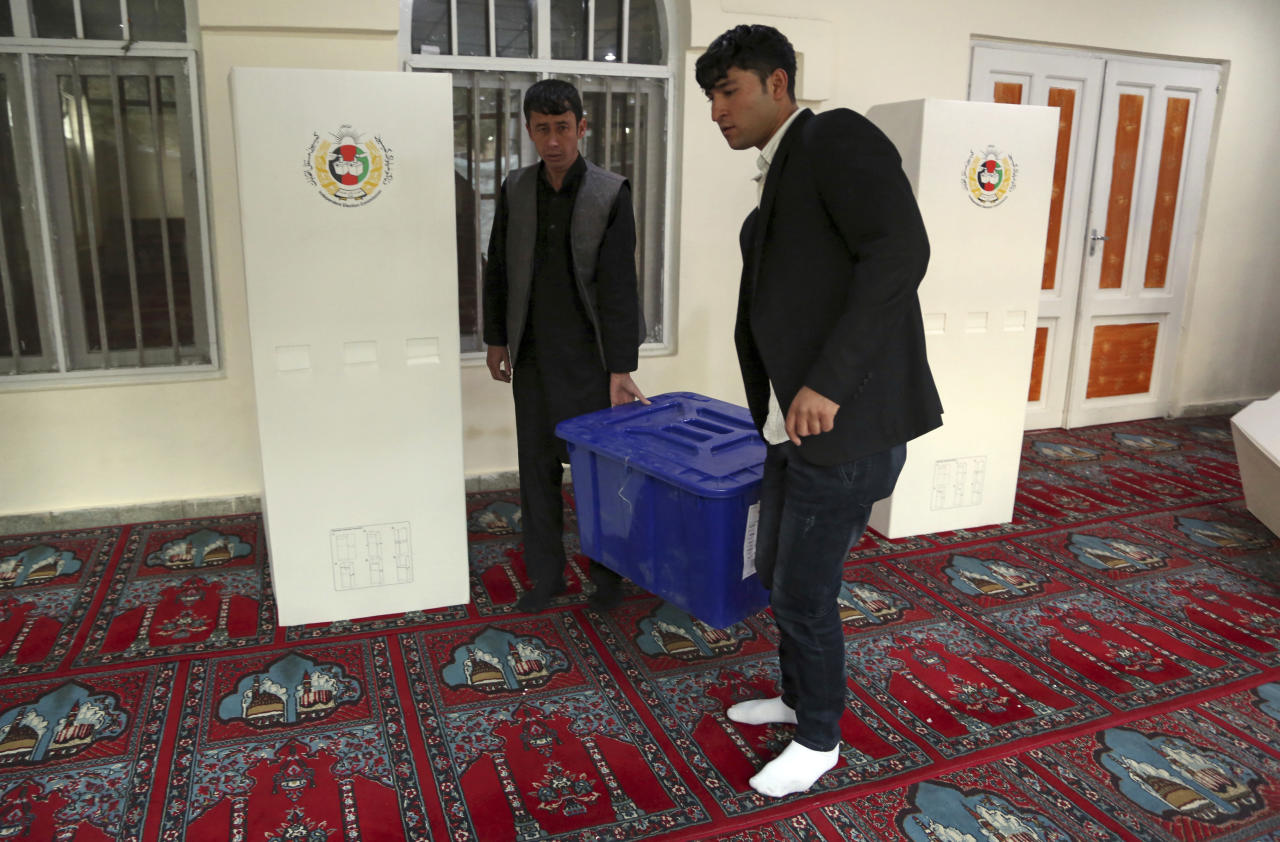 Afghan polling staff prepare for voting at a polling station during the Parliamentary election in Kabul, Afghanistan, Saturday, Oct. 20, 2018. (AP Photo/Rahmat Gul)