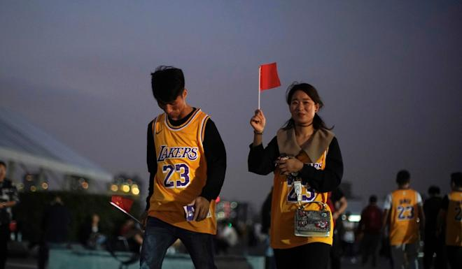 Chinese basketball fans walk into the Mercedes-Benz Arena for the preseason NBA game in Shanghai on Thursday. Photo: Reuters