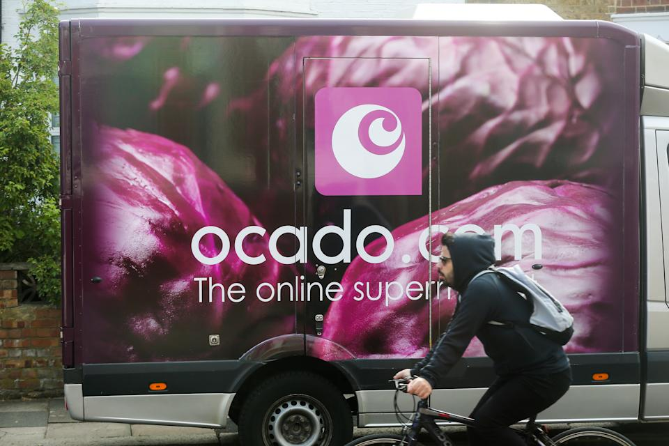 LONDON, UNITED KINGDOM - 2020/06/12: A cyclist rides past an Ocado delivery van. (Photo by Dinendra Haria/SOPA Images/LightRocket via Getty Images)