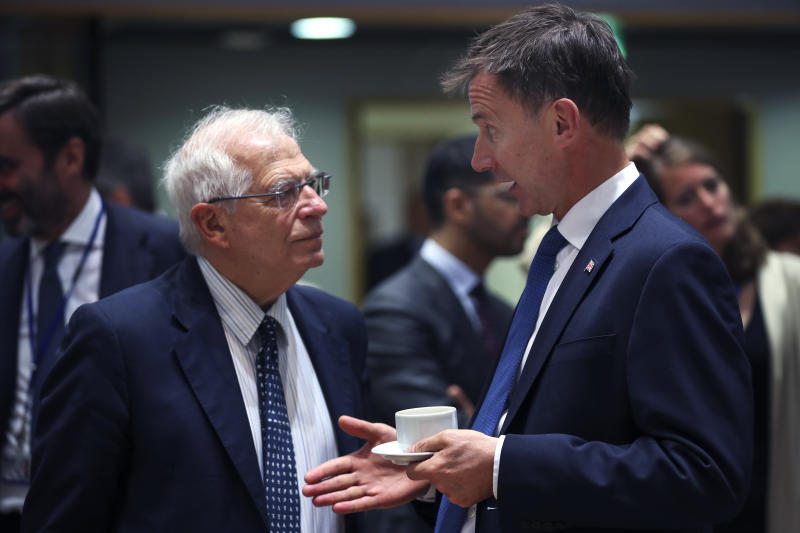 Britain's Foreign Secretary Jeremy Hunt, right, talks to his Spanish counterpart Josep Borrell during a European Foreign Affairs meeting at the European Council headquarters in Brussels, Monday, July 15, 2019. European Union nations were looking to deescalate tensions in the Persian Gulf area on Monday and call on Iran to stick to the 2015 nuclear deal, despite the pullout of the United States from the accord and the re-imposition of U.S. sanctions on Tehran. (AP Photo/Francisco Seco)