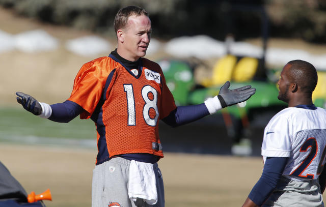 Denver Broncos quarterback Peyton Manning (18) talks with cornerback Champ Bailey (24) during NFL football practice at the team's training facility in Englewood, Colo., Saturday, Jan. 25, 2014. The Broncos are scheduled to play the Seattle Seahawks in Super Bowl XLVIII on Feb. 2. (AP Photo/Ed Andrieski)