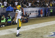 Green Bay Packers wide receiver Jarrett Boykin (11) looks back after running into the end zone with a touchdown after Packers quarterback Aaron Rodgers (12) fumbled the ball during the first half of an NFL football game against the Chicago Bears, Sunday, Dec. 29, 2013, in Chicago. (AP Photo/Charles Rex Arbogast)