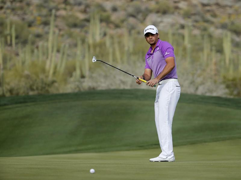 Jason Day watches his putt on the 16th hole in his third-round match against George Coetzee, of South Africa, at the Match Play Championship golf tournament, Friday, Feb. 21, 2014, in Marana, Ariz. (AP Photo/Matt York)