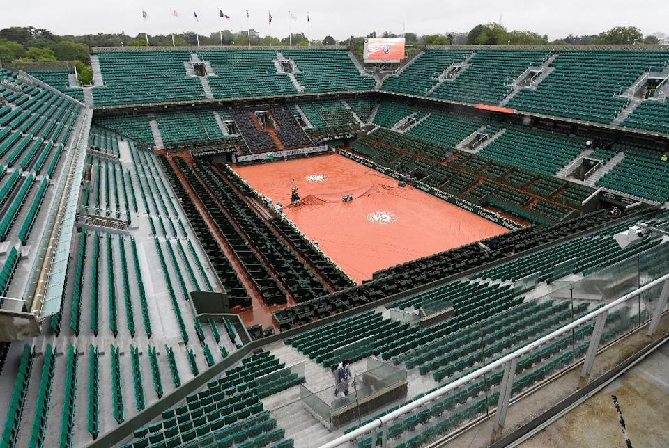 Under the original schedule at the French Open, all fourth round matches were to be completed on Monday, leaving Tuesday and Wednesday for the quarter-finals (AFP Photo/Miguel Medina)