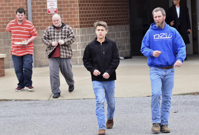 <p>Family members escort their children out of Marshal North Middle School near Palma, Ky., Tuesday, Jan. 23, 2018, after being transported from the Marshal High School. (Photo: Stephen Lance Dennee/AP) </p>