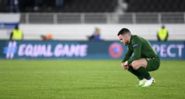 Aaron Connolly reacts after the defeat