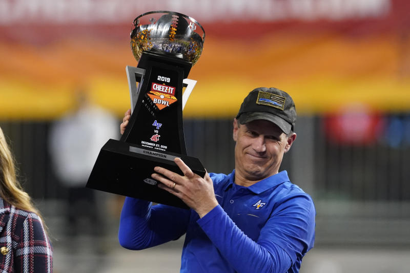 Air Force head coach Troy Calhoun celebrates after defeating Washington State 31-21 during the Cheez-It Bowl NCAA college football game, Friday, Dec. 27, 2019, in Phoenix. (AP Photo/Rick Scuteri)