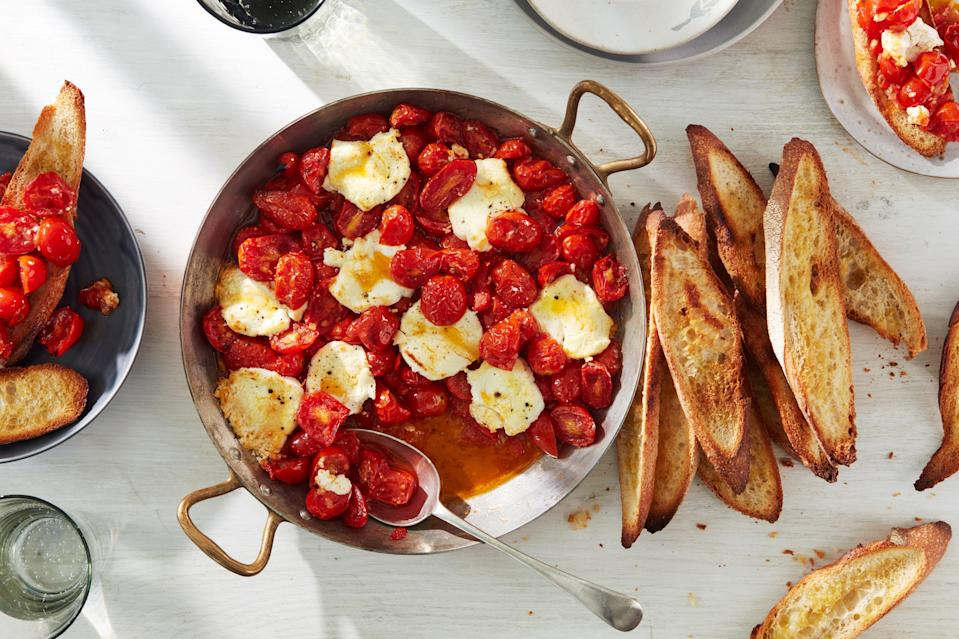 "Dip slices of baguette into a pan of juicy baked cherry tomatoes and creamy goat cheese. Then repeat. <a href=""https://www.epicurious.com/recipes/food/views/baked-tomatoes-peppers-and-goat-cheese-with-crisped-toasts?mbid=synd_yahoo_rss"" rel=""nofollow noopener"" target=""_blank"" data-ylk=""slk:See recipe."" class=""link rapid-noclick-resp"">See recipe.</a>"