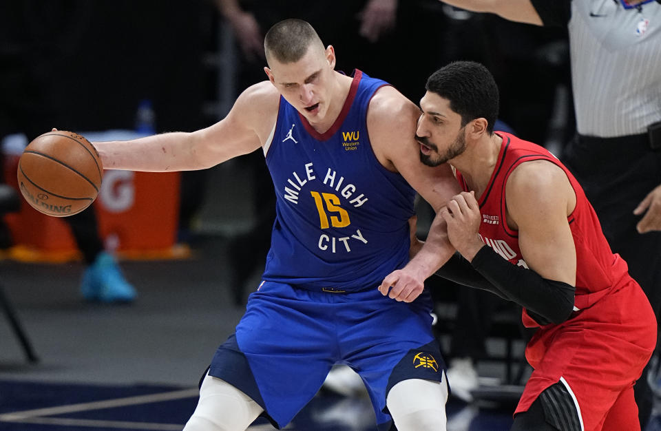 Denver Nuggets center Nikola Jokic (15) moves against Portland Trail Blazers center Enes Kanter (11) in the second half of Game 1 of a first-round NBA basketball playoff series Saturday, May 22, 2021, in Denver. (AP Photo/Jack Dempsey)