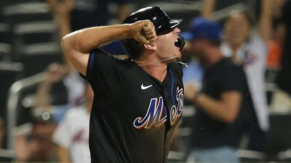Aug 13, 2021; New York City, NY, USA; New York Mets first baseman Pete Alonso (20) reacts after scoring against the Los Angeles Dodgers on a wild pitch during the seventh inning at Citi Field.