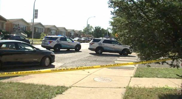 PHOTO: Police officers work outside the area where two sisters were shot on Aug. 15, 2021 in Belmont Central on Chicago's Northwest Side, according to Chicago police. (WLS-TV Chicago)