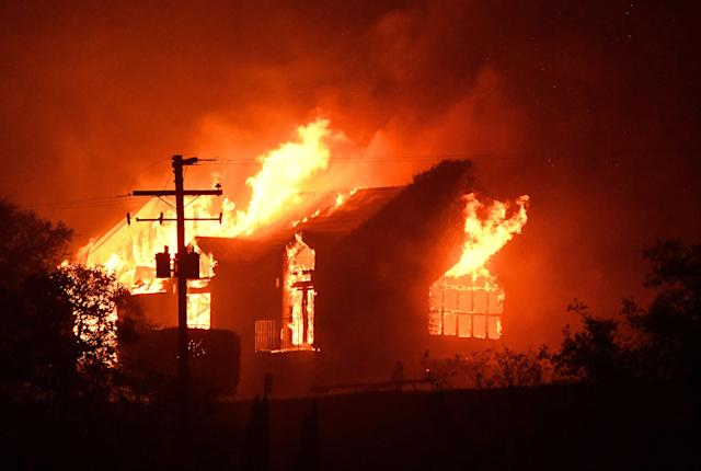 <p>The Signorello Estate Winery burns in the Napa wine region in Calif., on Oct. 9, 2017, as multiple wind-driven fires continue to whip through the region. (Photo: Josh EdelsonAFP/Getty Images) </p>