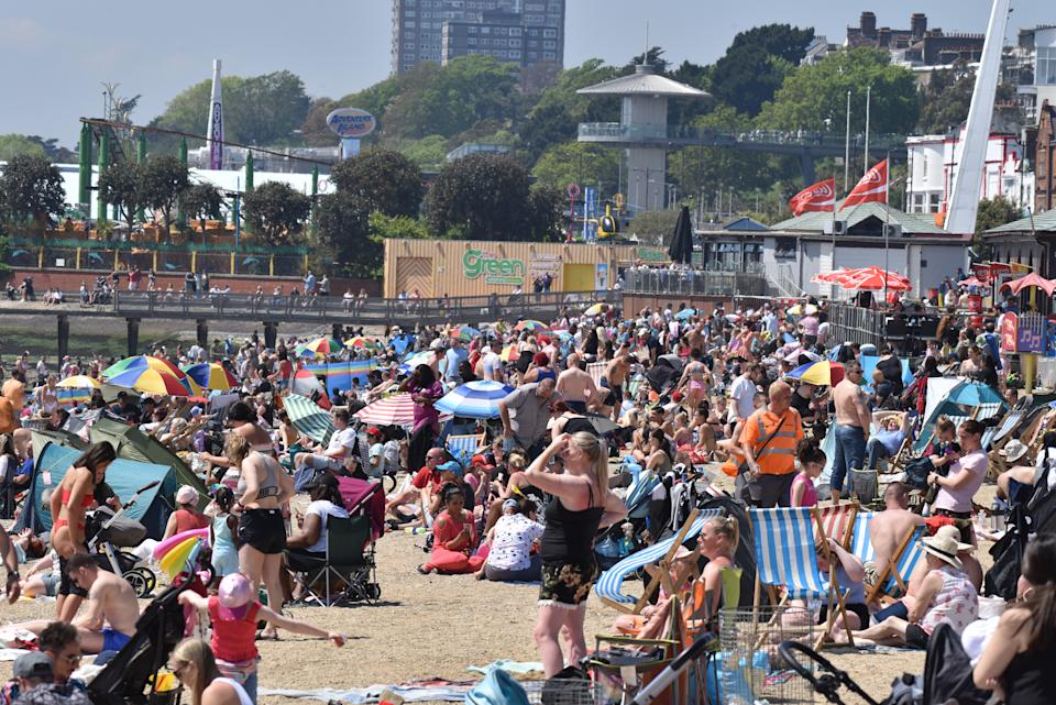 SOUTHEND, ENGLAND - MAY 31: Crowds gather to enjoy the warm sunny weather on Jubilee beach on May 31, 2021 in Southend, England. Today's bank holiday Monday brings highs of 77F (25C) and could be the hottest day of 2021 so far and the start of a 13-day heatwave. The continued spread of the Indian variant of coronavirus has cast doubt on the restrictions being lifted on June 21.  (Photo by John Keeble/Getty Images)
