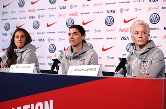 Carli Lloyd (left), Alex Morgan (center) and Megan Rapinoe answer questions at Friday's U.S. women's national team media day in New York City. (Getty)