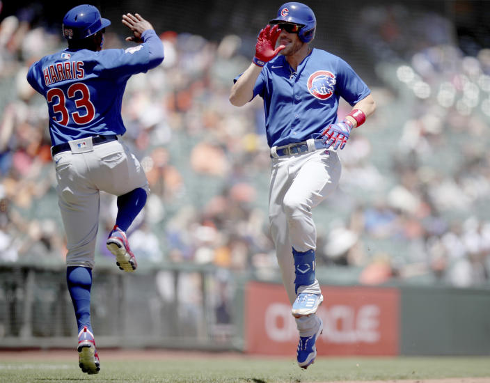 Chicago Cubs' Patrick Wisdom, right, celebrates with third base coach Willie Harris after a home run in the second inning of a baseball game against the Chicago Cubs, Sunday, June 6, 2021, in San Francisco. (AP Photo/Scot Tucker)