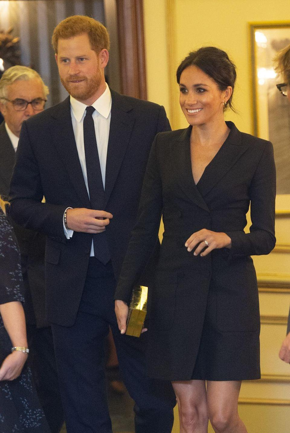 """<p>Meghan Markle was the subject of fashion controversy yet again when she wore this modern black tuxedo dress from Judith and Charles to a 2018 performance. Some <a href=""""https://www.marieclaire.com/fashion/a22871948/meghan-markles-hamilton-tuxedo-dress-protocol/"""" rel=""""nofollow noopener"""" target=""""_blank"""" data-ylk=""""slk:UK tabloids criticized the look"""" class=""""link rapid-noclick-resp"""">UK tabloids criticized the look</a>, because she broke two of the supposed style rules for royals: The hemline hit above her knee and she neglected to wear nude tights underneath the dress. </p>"""