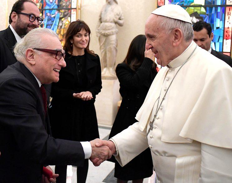 Pope Francis shakes hands with director Martin Scorsese, left, on the occasion of their private audience at the Vatican, Wednesday, Nov. 30, 2016. Francis has met with Scorsese, whose new film,