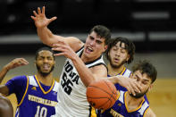 Iowa center Luka Garza (55) fights for a rebound with Western Illinois forward Will Carius, right, during the second half of an NCAA college basketball game, Thursday, Dec. 3, 2020, in Iowa City, Iowa. (AP Photo/Charlie Neibergall)