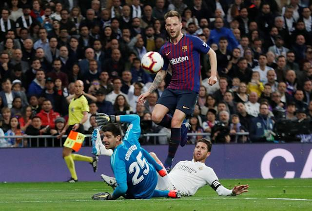 "Soccer Football - La Liga Santander - <a class=""link rapid-noclick-resp"" href=""/soccer/teams/real-madrid/"" data-ylk=""slk:Real Madrid"">Real Madrid</a> v FC Barcelona - Santiago Bernabeu, Madrid, Spain - March 2, 2019 Barcelona's Ivan Rakitic scores their first goal REUTERS/Juan Medina"