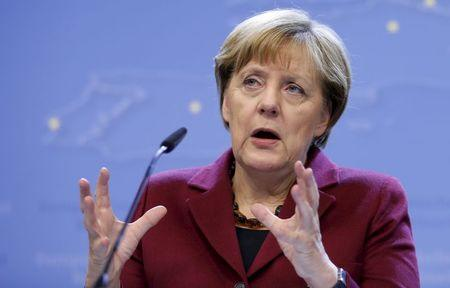 Germany's Chancellor Merkel addresses a news conference after an EU leaders summit in Brussels