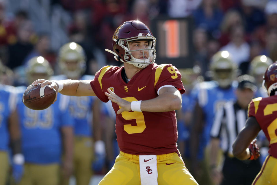 FILE - In this Nov. 23, 2019, file photo, Southern California quarterback Kedon Slovis throws against UCLA during the first half of an NCAA college football game, in Los Angeles. Slovis was selected as The Associated Press Pac 12 Conference team Newcomer of the Year and will start his sophomore year in November. (AP Photo/Marcio Jose Sanchez, File)