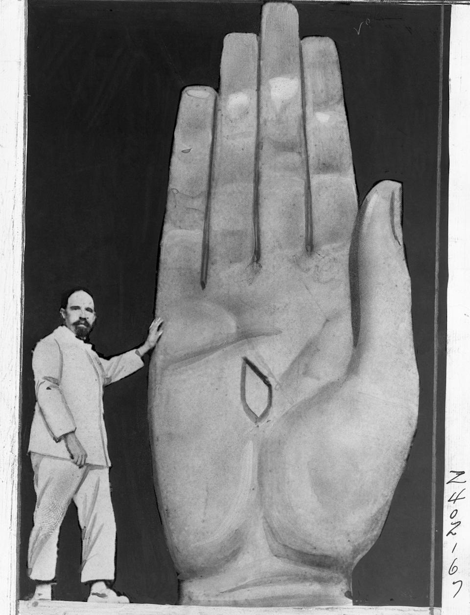 Polish sculptor, shown at work on the hand of the giant statue of Christ which he is completing and which will be placed in Rio De Janeiro Bay, South America.
