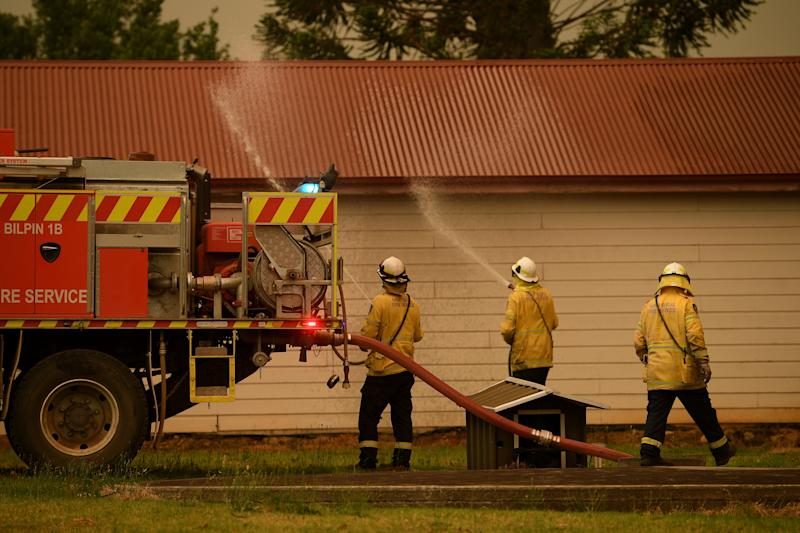 NSW Rural Fire Service crews protect property as the Gospers Mountain Fire approaches Bilpin.