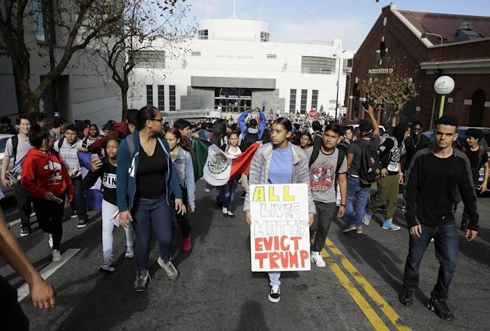 <p>High school student protesters march in front of the Maritime Museum in opposition of Donald Trump's presidential election victory in San Francisco, Thursday, Nov. 10, 2016. (AP Photo/Eric Risberg) </p>