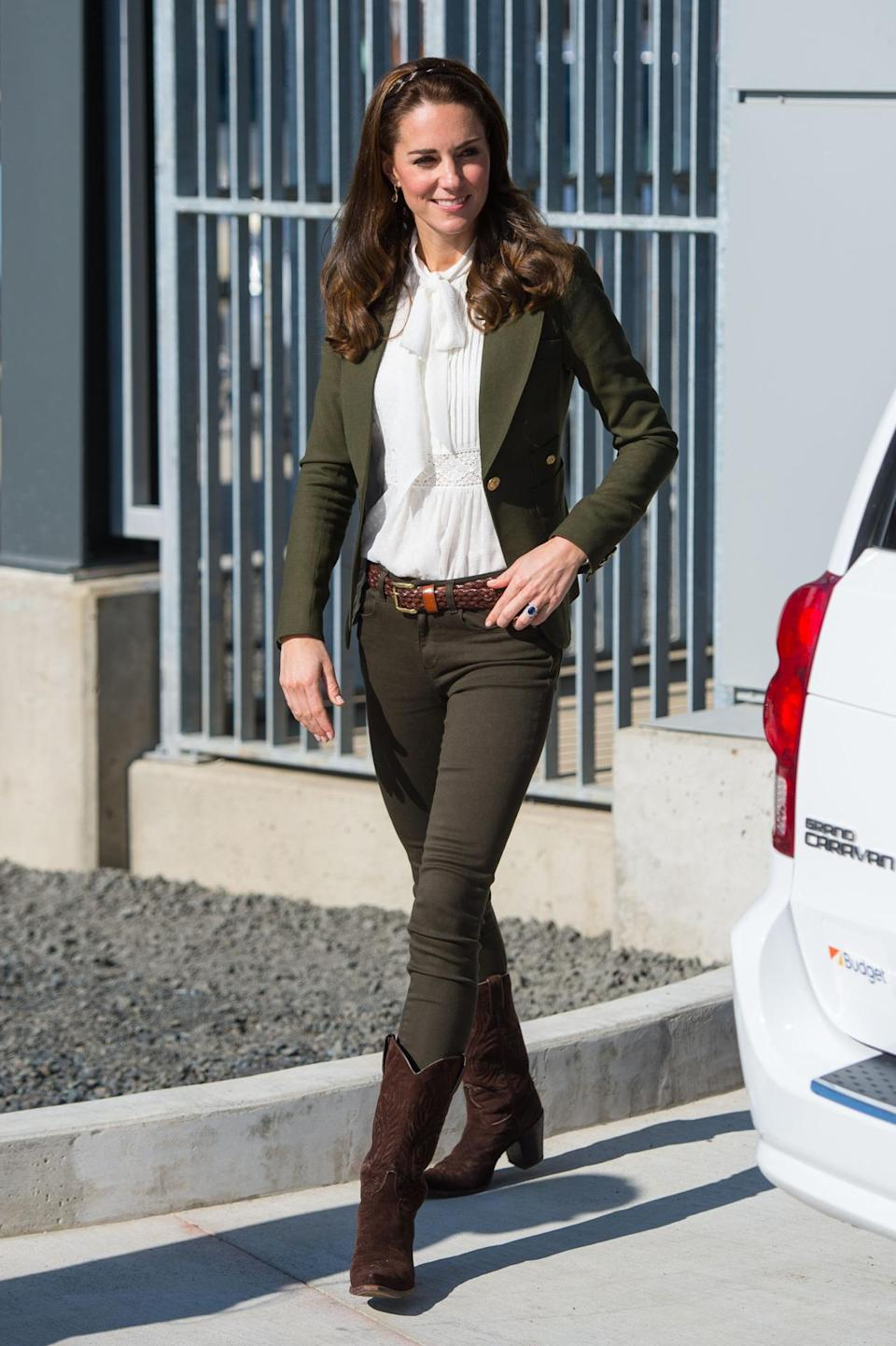 """<p>For a canoe trip, Kate wore an army green blazer by Toronto-based brand, Smythe Les Vests. She paired it with a white lacy blouse designed by Alice Temperley for John Lewis. It costs £79 and is <a rel=""""nofollow noopener"""" href=""""http://www.johnlewis.com/somerset-by-alice-temperley-spot-pretty-blouse/p2891104?colour=Ivory#media-overlay_show&s_afcid=af_136348&awc=1203_1475312729_814bd43227fc7bed5aca3a86c46d9873"""" target=""""_blank"""" data-ylk=""""slk:still available online"""" class=""""link rapid-noclick-resp"""">still available online</a> - but hurry. The rest of her outfit consisted of Zara jeans and suede cowboy boots from R Soles. </p><p><i>[Photo: PA]</i></p>"""