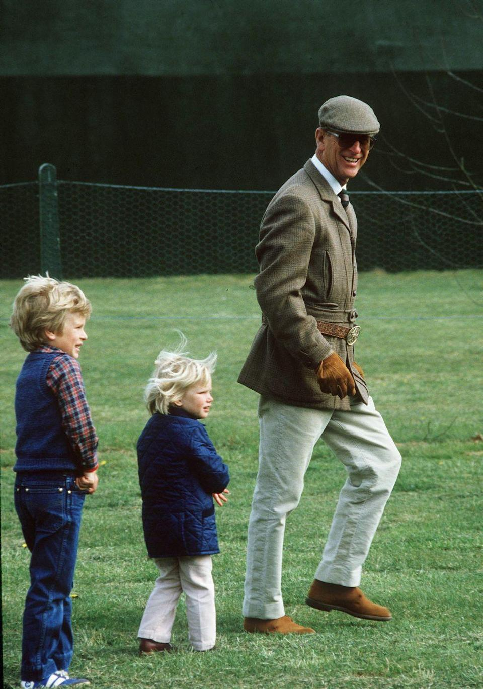 """<p>Prince Philip became a grandfather for the first time when Peter Phillips is born. Princess Anne would later give birth to his first granddaughter, <a href=""""https://www.goodhousekeeping.com/life/a20685936/zara-phillips-full-name/"""" rel=""""nofollow noopener"""" target=""""_blank"""" data-ylk=""""slk:Zara Phillips"""" class=""""link rapid-noclick-resp"""">Zara Phillips</a>, on May 15, 1981.</p>"""