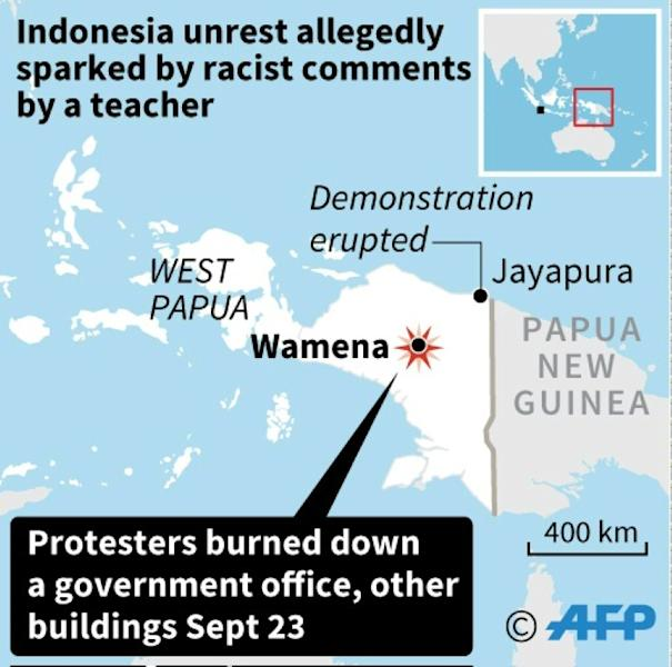 Some 22 people died in Wamena city where hundreds had demonstrated and burned down agovernment office and other buildings