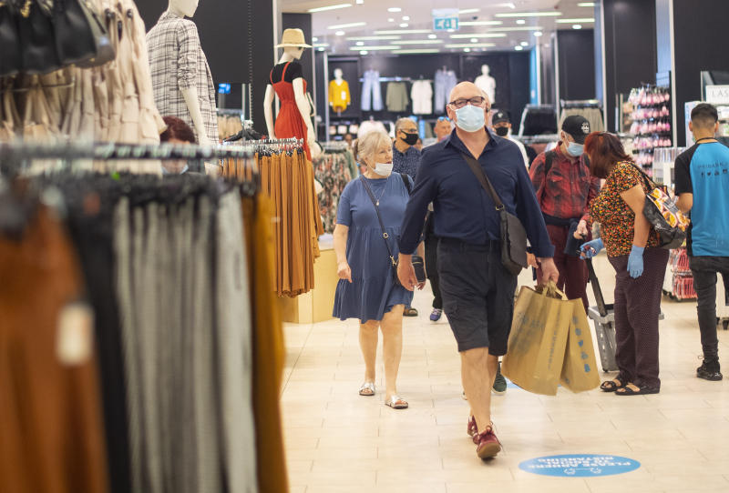 File photo dated 15/06/20 of customers wearing face masks as they shop inside Primark in Oxford Street, London. Face coverings could be made mandatory in shops in England, Boris Johnson has hinted, as he urged Britons to go back to work if they can.
