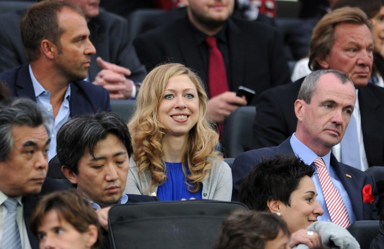 Daughter of Bill and Hillary Clinton Chelsea Clinton (C) and US Ambassador to Germany Philip D. Murphy (R) attend the FIFA Women's Football World Cup final match Japan vs USA on July 17, 2011 in Frankfurt am Main, western Germany. AFP PHOTO / PATRIK STOLLARZ (Photo credit should read PATRIK STOLLARZ/AFP/Getty Images)