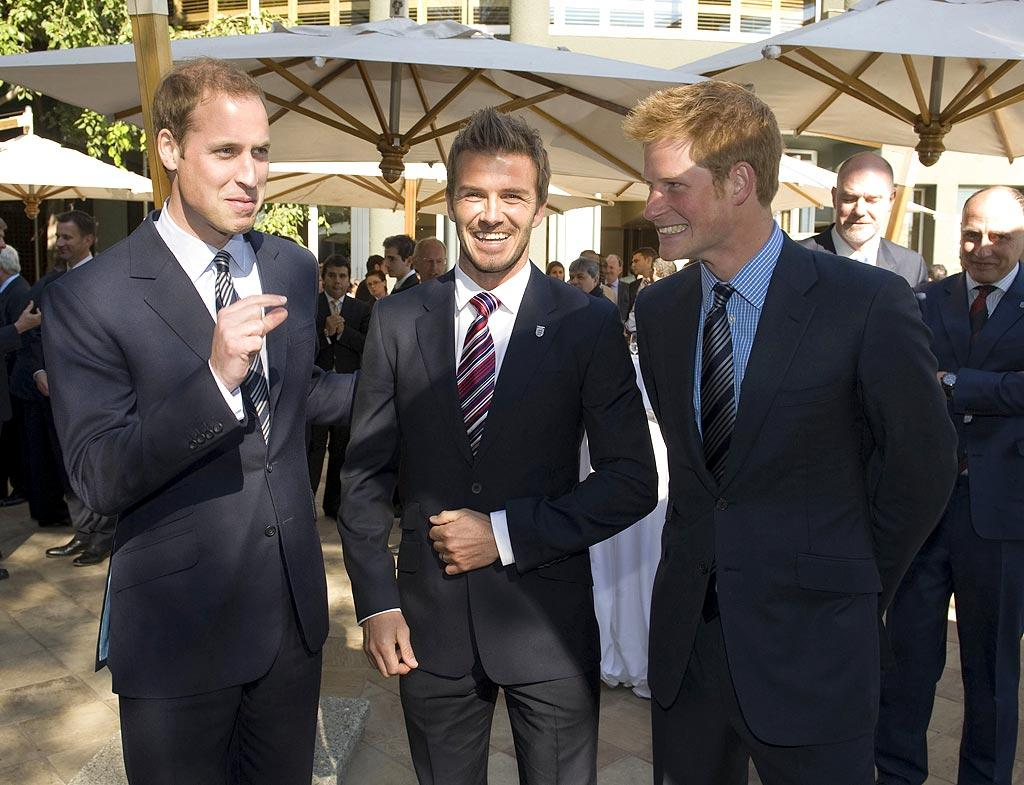 """Though he couldn't play for England in the World Cup due to an Achilles heel injury, David Beckham was cheered up by two royal jokers -- Prince William and Prince Harry -- at an English team function in Johannesburg, South Africa. Samir Hussein/<a href=""""http://www.wireimage.com"""" target=""""new"""">WireImage.com</a> - June 19, 2010"""