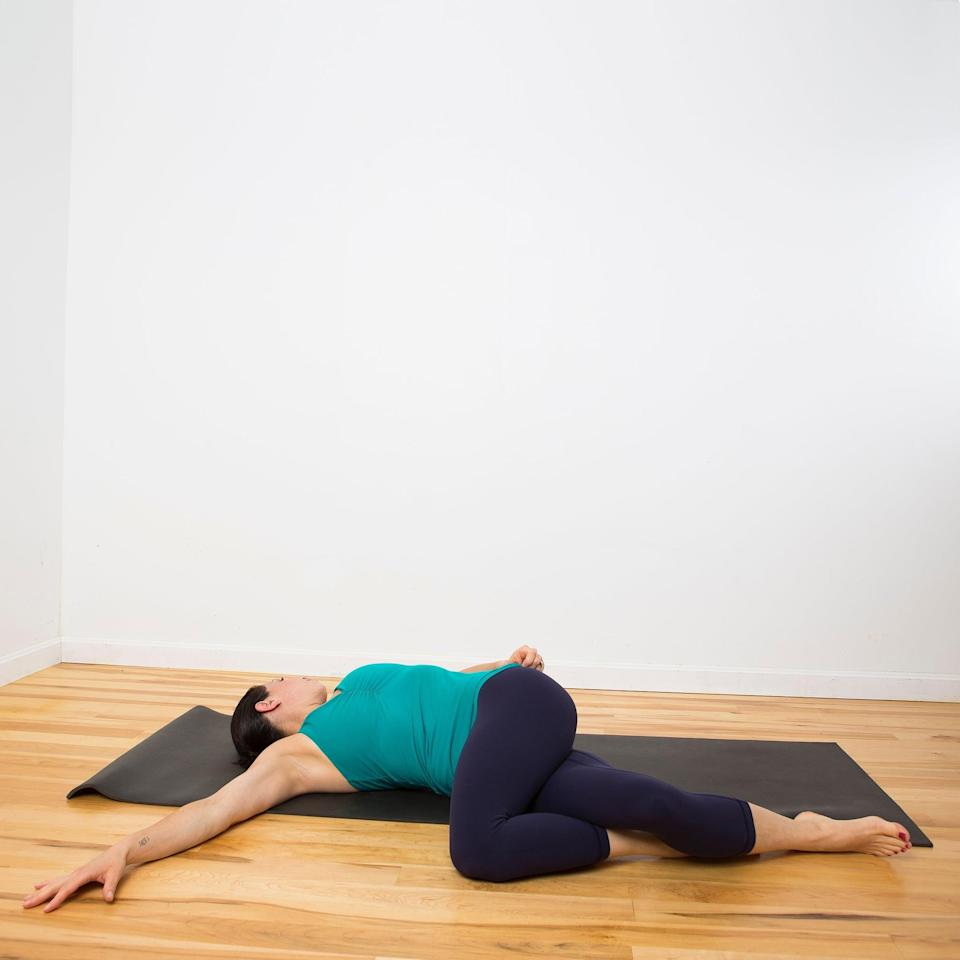 <ul> <li>From Figure Four on the left side, let go of your feet and bring your knees together.</li> <li>Extend your arms out in T-position.</li> <li>Slowly lower both knees to the right. Rest them on the ground, and turn your head to the left. You can increase the stretch by crossing the left knee over the right thigh.</li> <li>Hold here for five breaths, feeling your spine lengthen and twist. </li> <li>Use your abs to lift your knees back to center, then repeat on the other side.</li> </ul>
