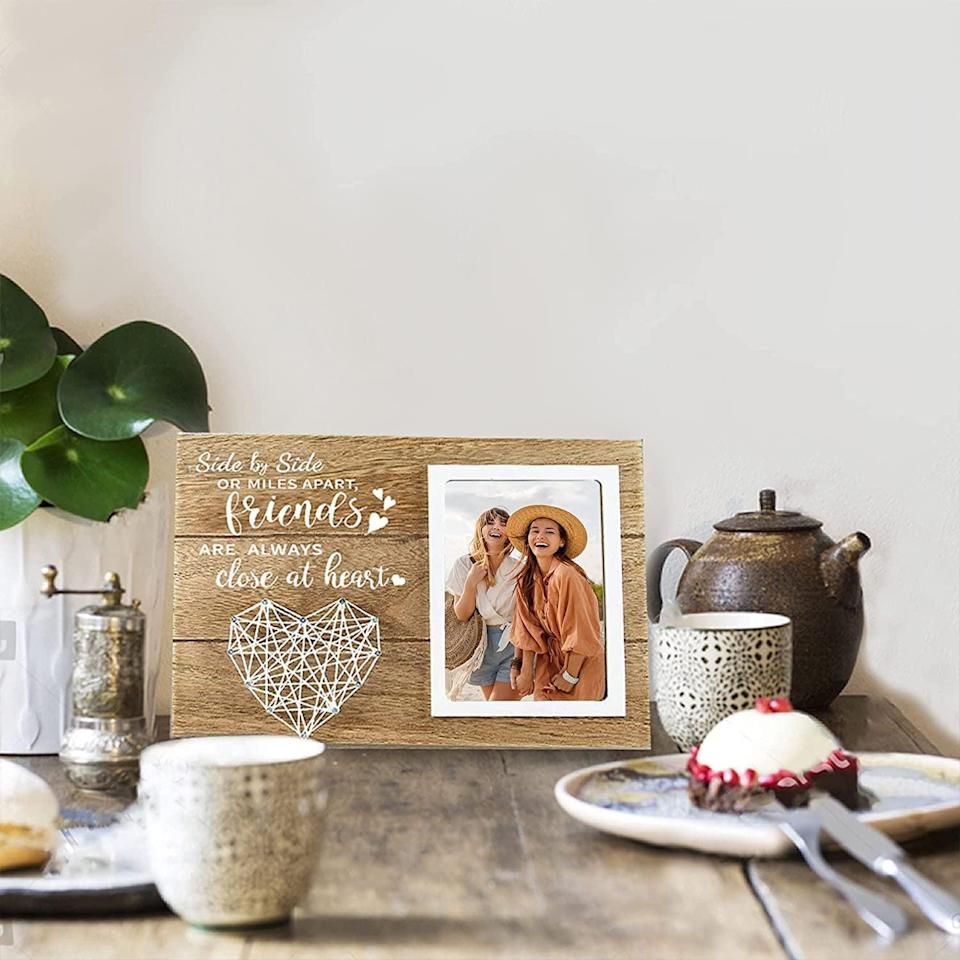 <p>Your bestie will adore this heartfelt <span>Cocomong Best Friend Picture Frame</span> ($25). They can hang it on their wall or display it on their coffee table.</p>