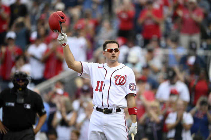 Washington Nationals' Ryan Zimmerman doffs his batting helmet to the crowd before batting during the second inning of a baseball game against the Boston Red Sox, Sunday, Oct. 3, 2021, in Washington. (AP Photo/Nick Wass)